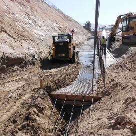 Back filling at footings of retaining wall along Temecula Parkway