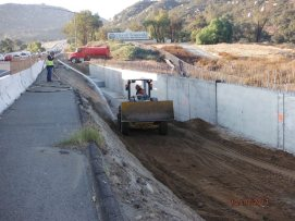 Back filling at retaining wall along southbound on-ramp