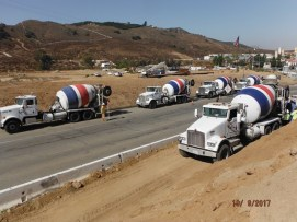 Concrete trucks along southbound on-ramp - lined up ready to pour