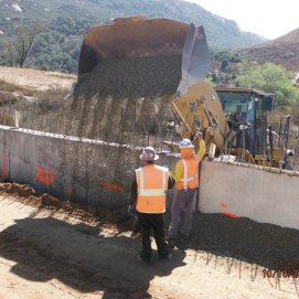 Placement of drain rock along at retaining wall southbound on-ramp