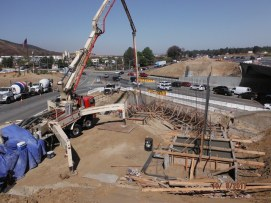 Pumping concrete at south bridge footings