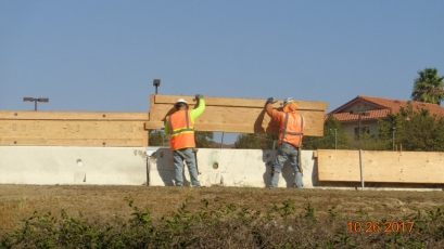 Placing Wood Panels for Protection at Concrete Barriers