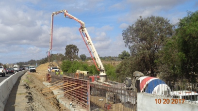 Pouring Concrete at Last Section of Retaining Wall Along North Bound On-ramp