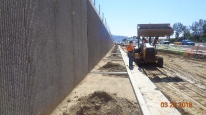 Drainage in sidewalk at RW 760